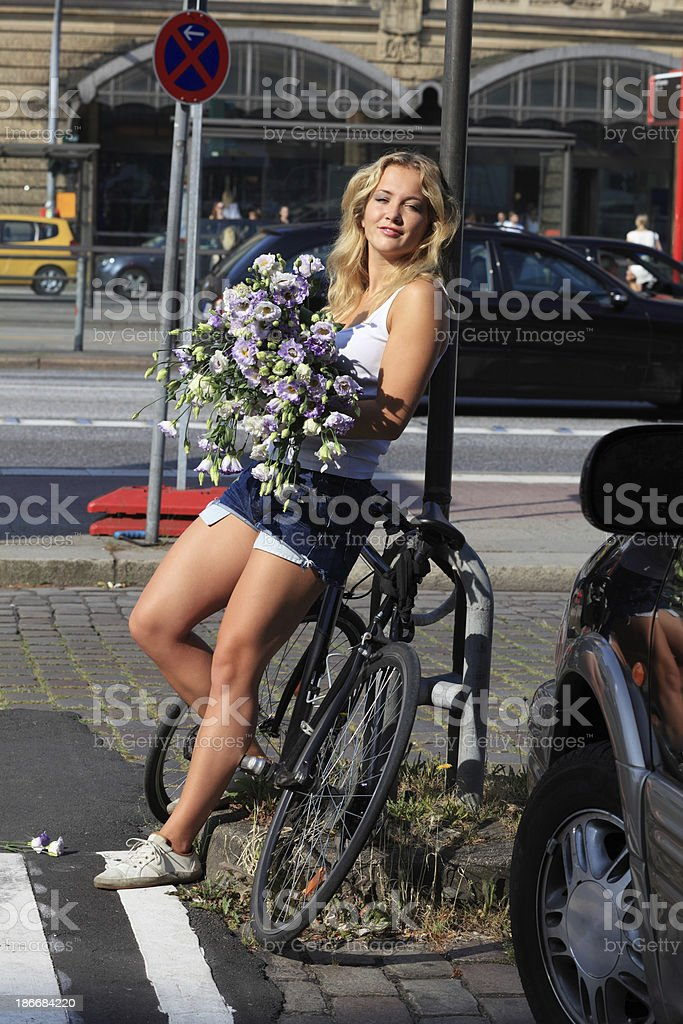 young woman with a lisianthus bouquet royalty-free stock photo