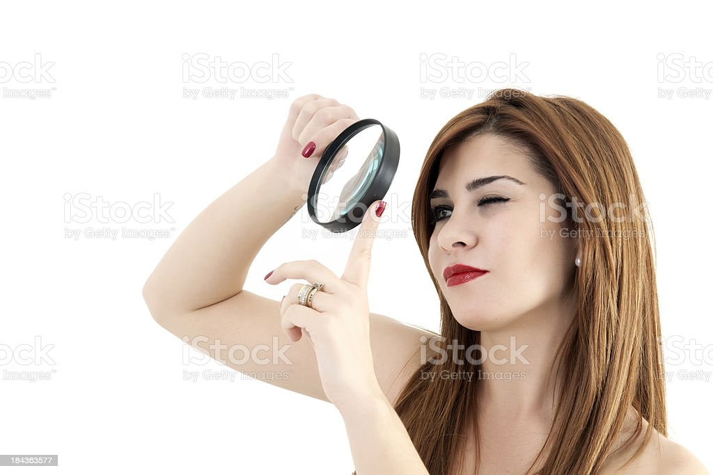 Young woman with a magnifying glass royalty-free stock photo