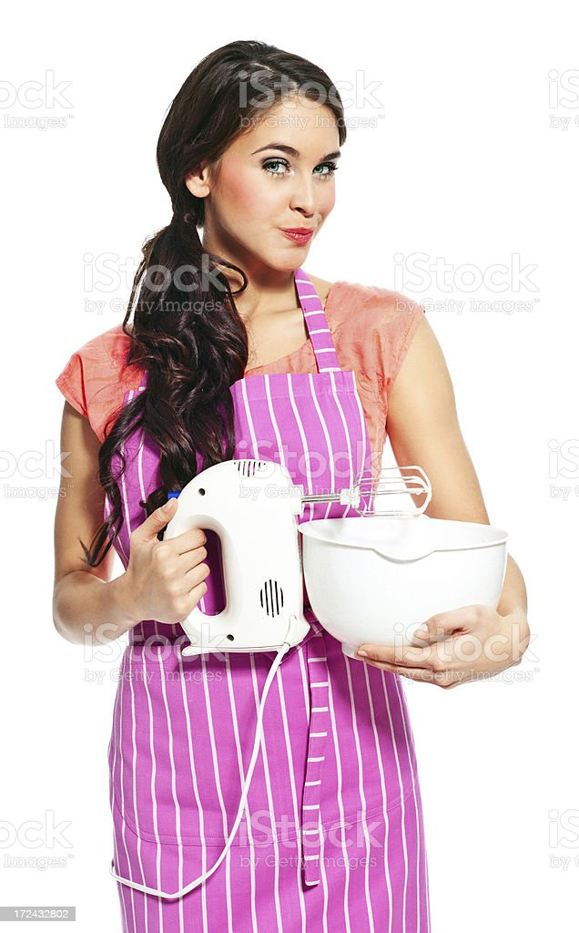 Young woman with a mixer Portrait of confident young housewife using a electric mixer, smirking at the camera. 20-24 Years Stock Photo