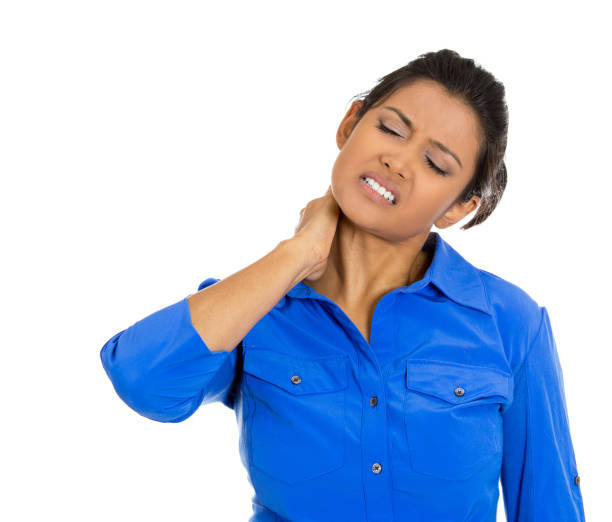 Young woman with a painful neck stock photo