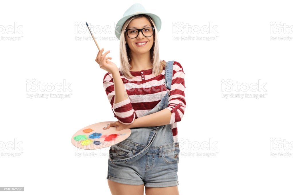 Young woman with a paintbrush and a color palette stock photo