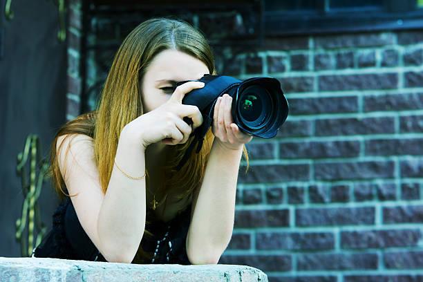 Young woman with a photo camera picture id93888416?b=1&k=6&m=93888416&s=612x612&w=0&h=a1mermwvs2kqyhi1qnircdcvp 5ejmsrmq8jswsj3ys=