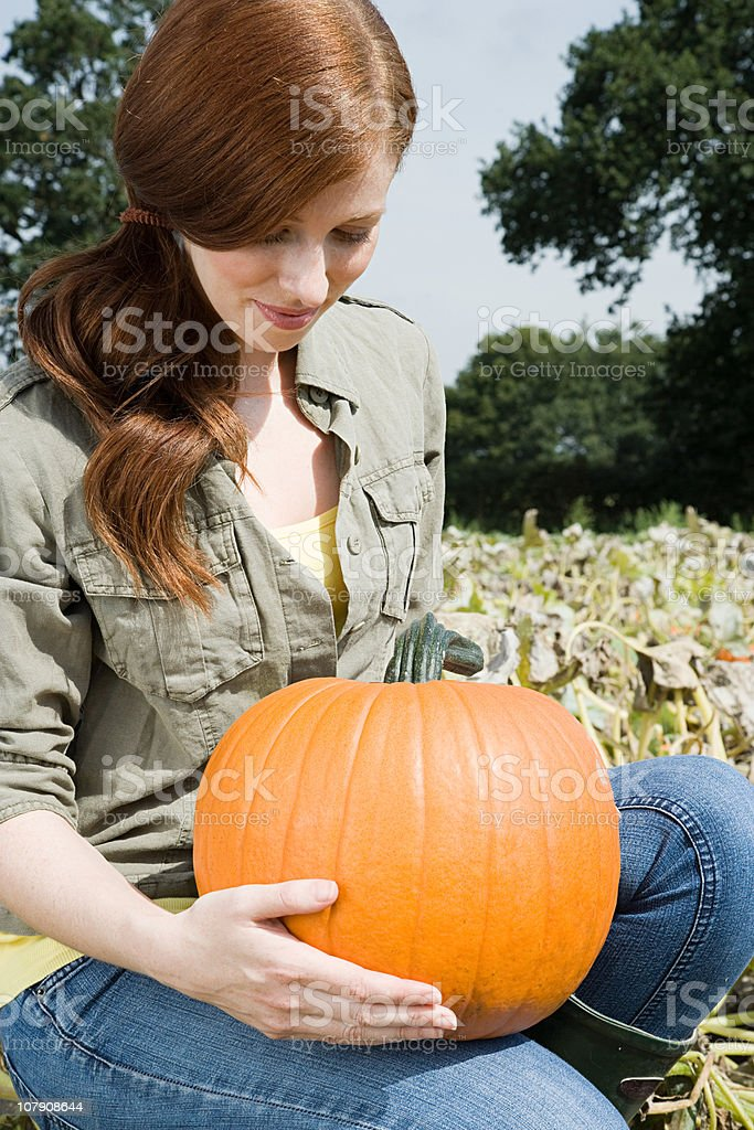 Young woman with a pumpkin royalty-free stock photo
