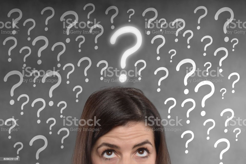 young woman with a question mark on her head stock photo