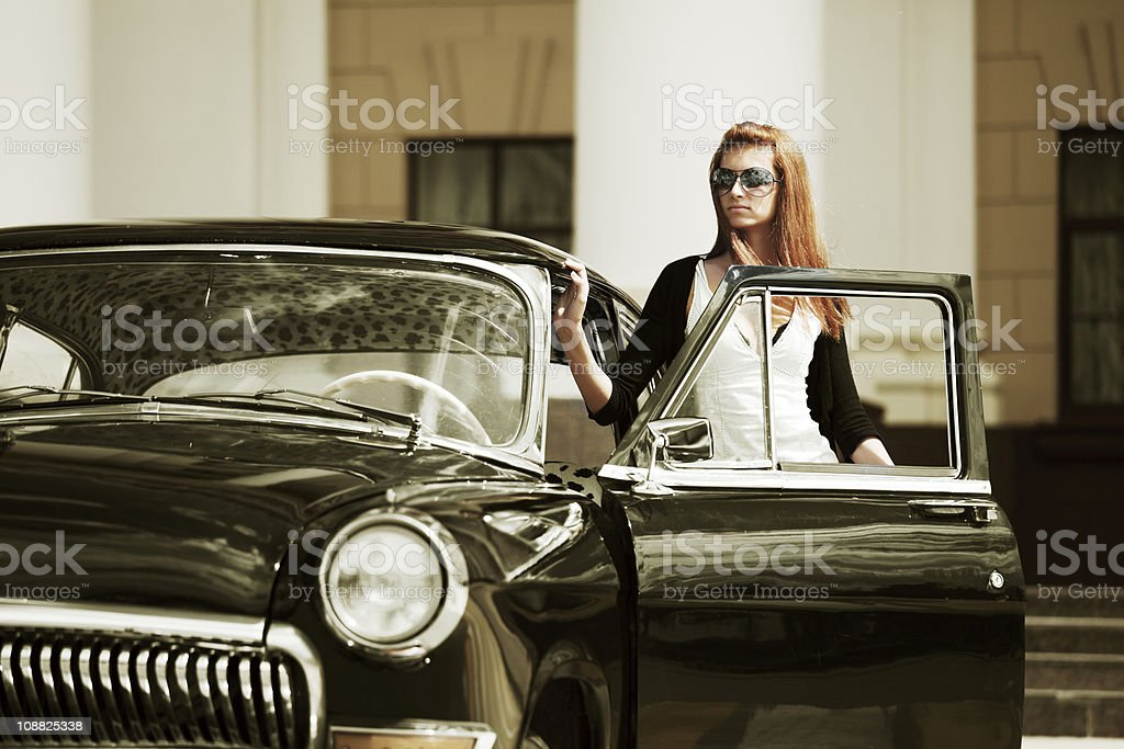 Young woman with a retro car. royalty-free stock photo