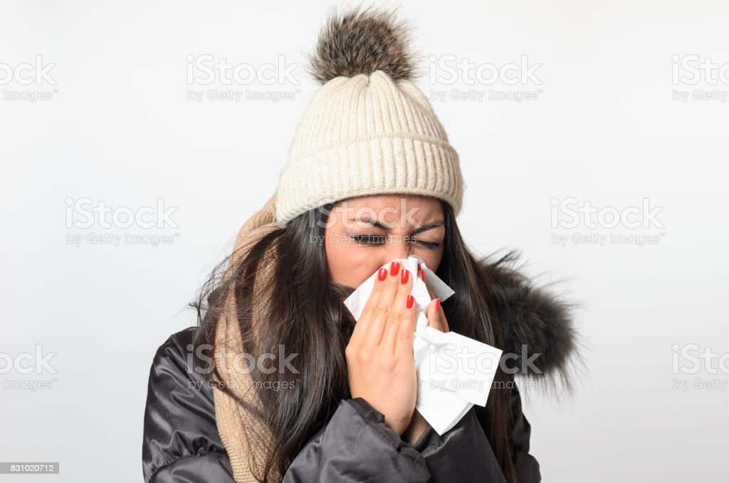 Young woman with a seasonal winter cold stock photo