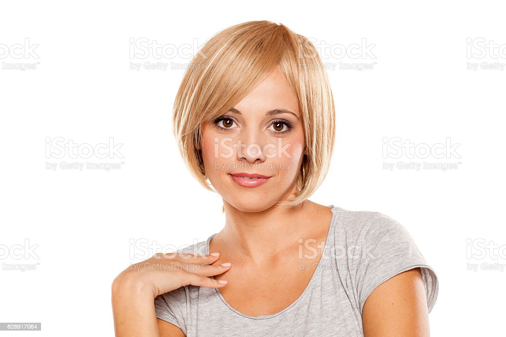 young woman with a short blond wig on her head stock photo