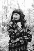 Portrait of an attractive young woman outdoor. Black and white photo.
