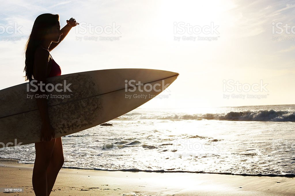 Young woman with a surf board on beach royalty-free stock photo