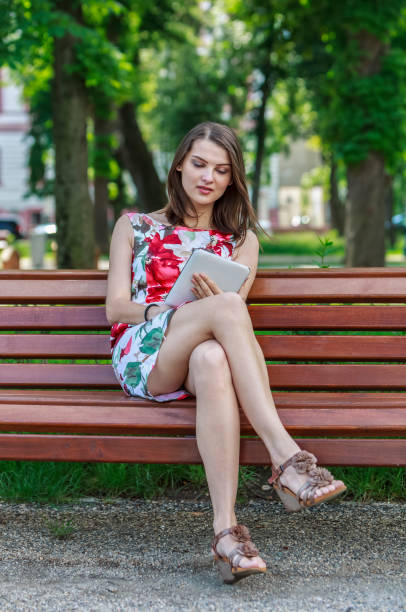 Young Woman with a Tablet in a Park stock photo