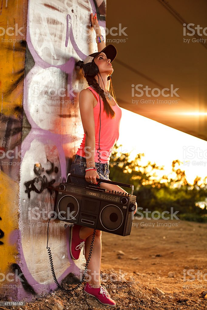 Young woman with a tape recorder and headphones royalty-free stock photo