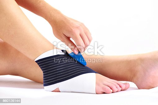 867056016istockphoto Young woman with ankle stabilizer 860126144