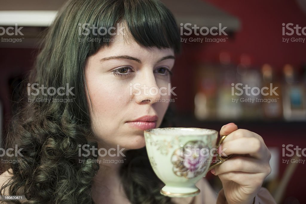 Young Woman with Antique Tea Cup royalty-free stock photo
