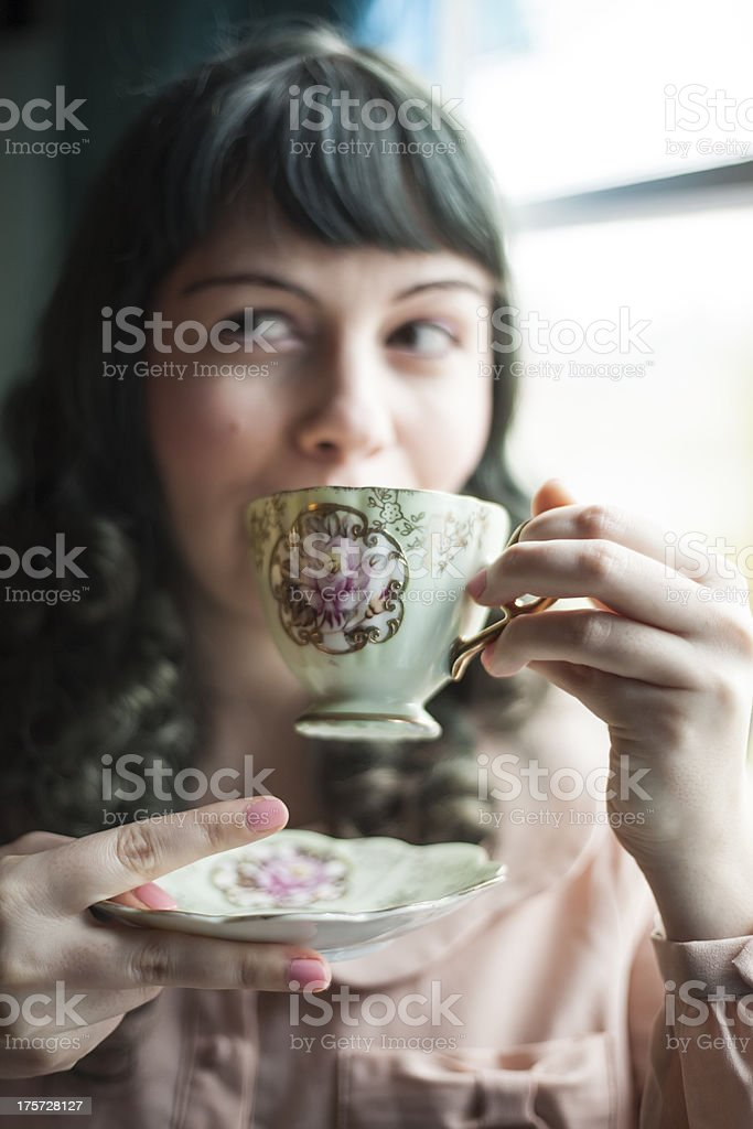 Young Woman with Antique Tea Cup stock photo