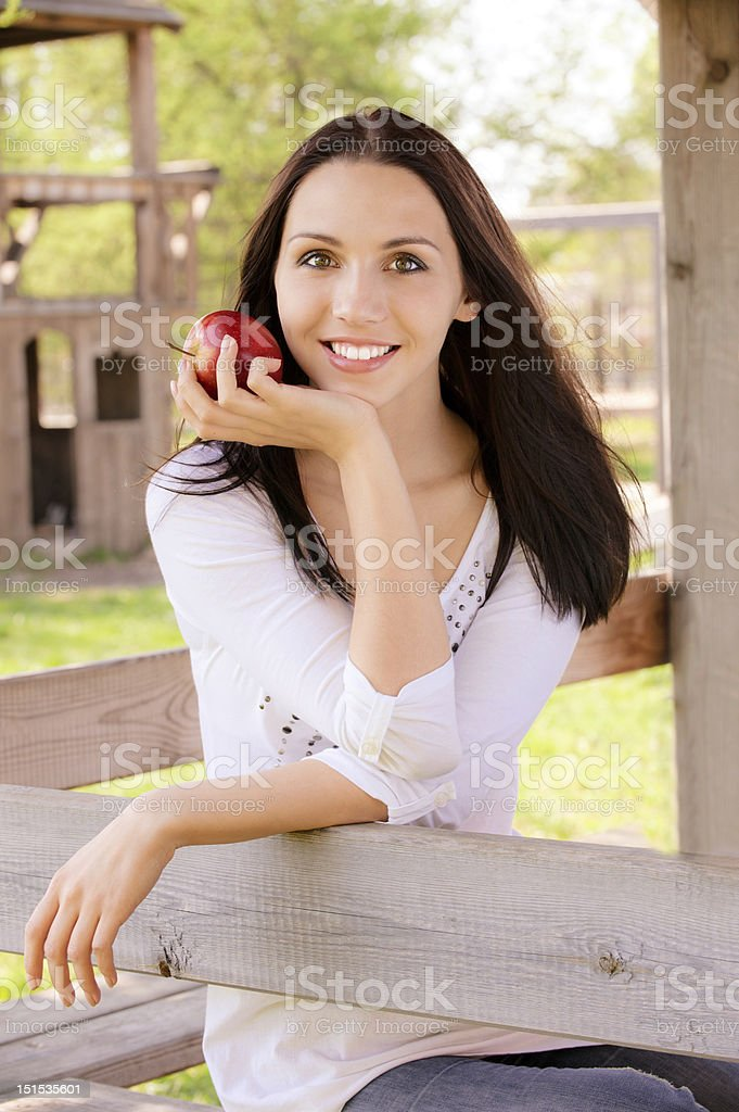 Young woman with apple royalty-free stock photo