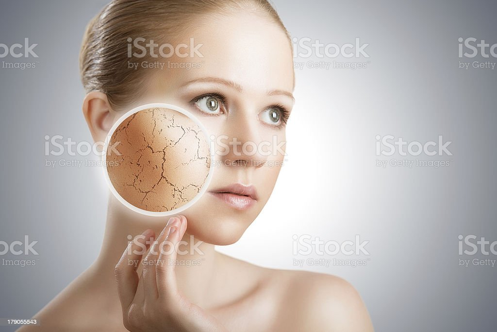 Young woman with area of skin magnified stock photo