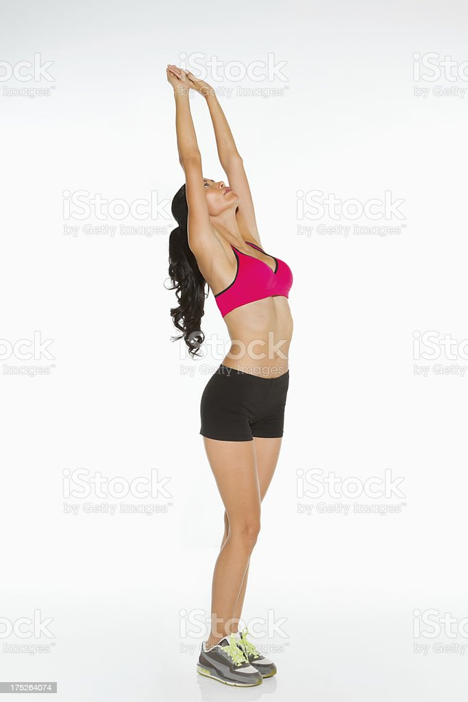 Young Woman With Arms Raised Exercising royalty-free stock photo