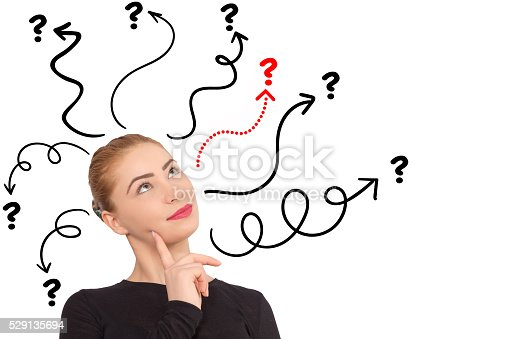 istock Young woman with arrows and questions sign above isolated 529135694