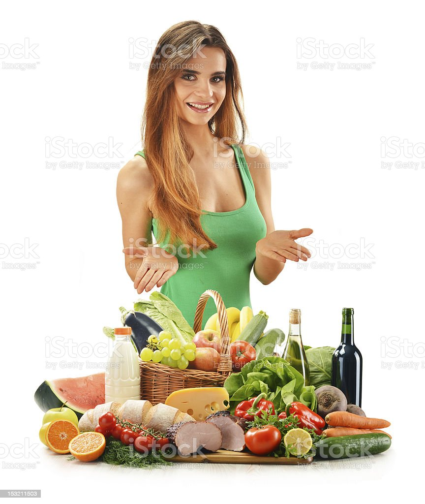 Young woman with assorted grocery products isolated on white stock photo