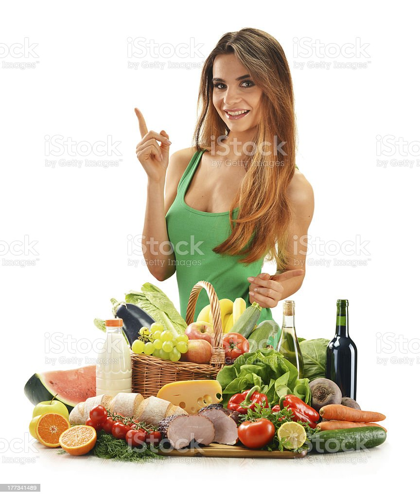 Young woman with assorted grocery products isolated on white royalty-free stock photo