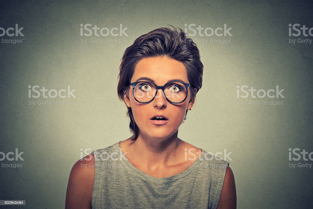 Young woman with astonished scared face expression stock photo