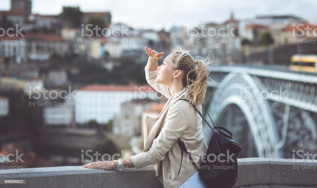 Young woman with backpack on the european streets stock photo