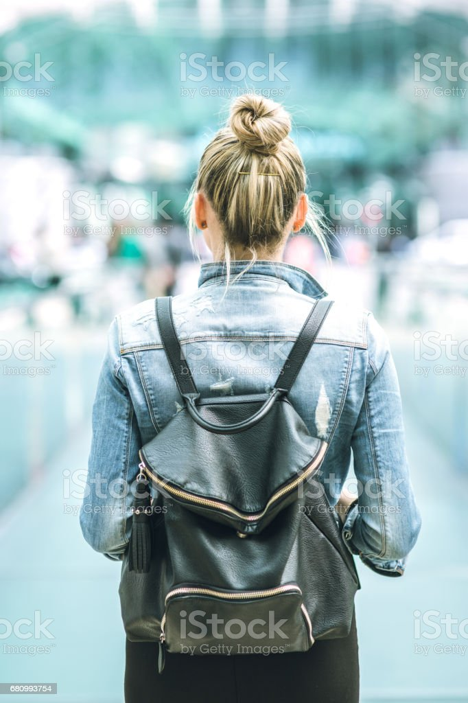 Young woman with backpack walking on the european streets royalty-free stock photo