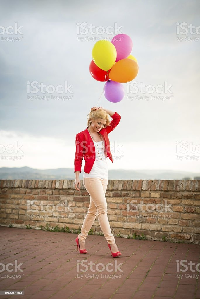 Young woman with balloons royalty-free stock photo