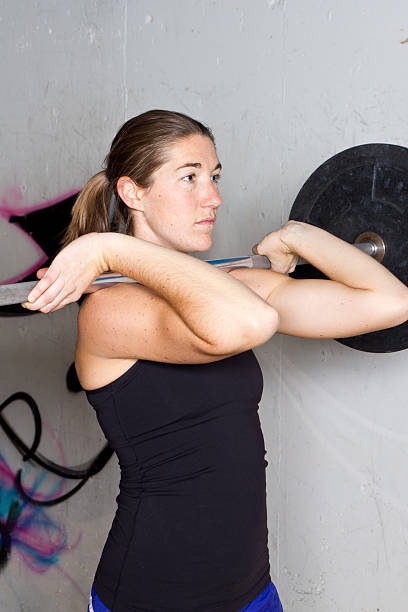Young Woman with Barbell stock photo