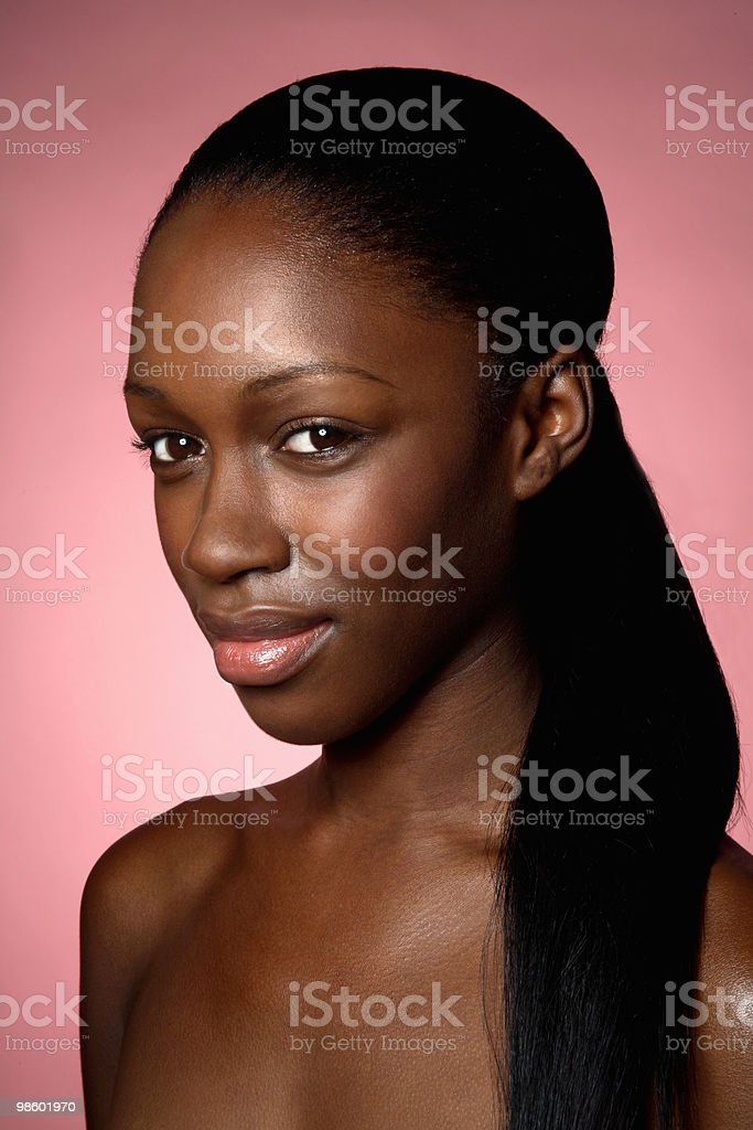 Young woman with bare shoulders and ponytail royalty-free stock photo