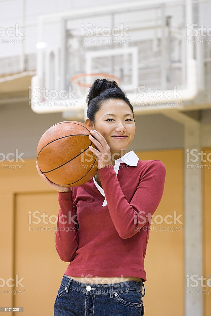 Young woman with basketball royalty-free stock photo