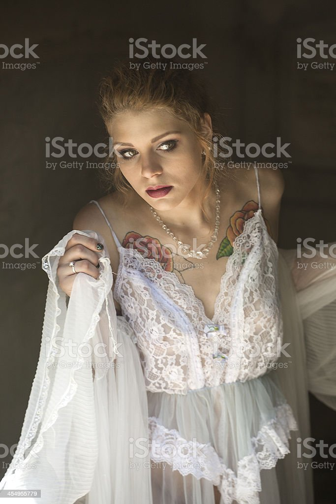 Young Woman with Beautiful Green Eyes iin Her Lingerie stock photo