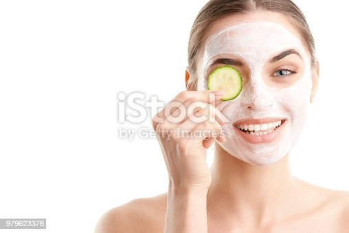 istock Young woman with beauty mask on her face 979623376
