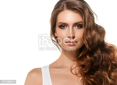 istock Young woman with beauty skin and beauty hairstyle isolated on white. 872065914