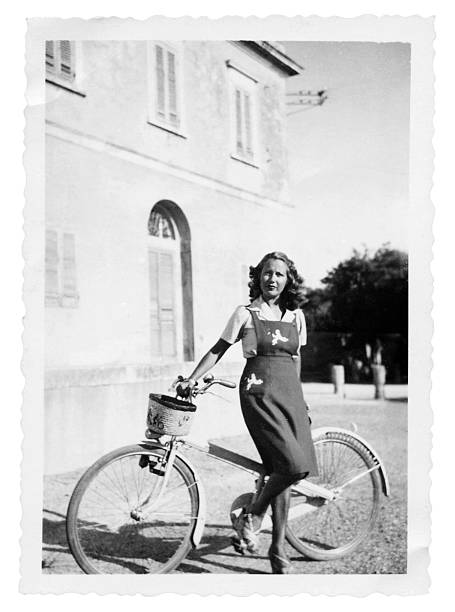 young woman with bicycle in 1935.black and white - 1940s style stock photos and pictures