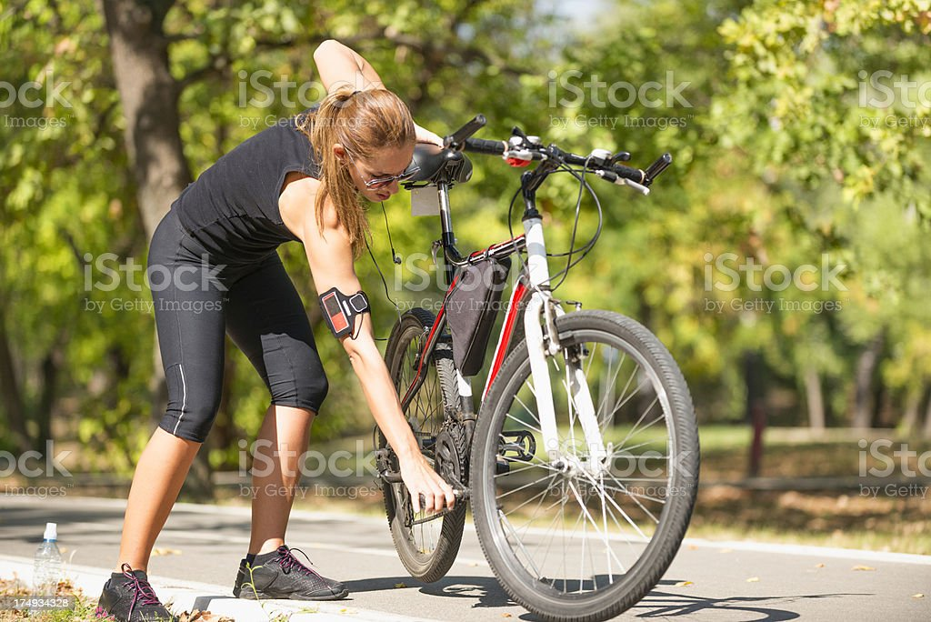 Young woman with bicycle royalty-free stock photo