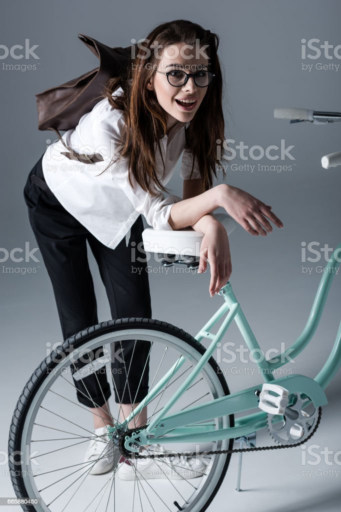 Young woman with bicycle stock photo