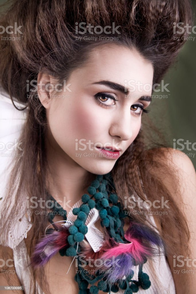 Young Woman With Big Hair and Necklace royalty-free stock photo