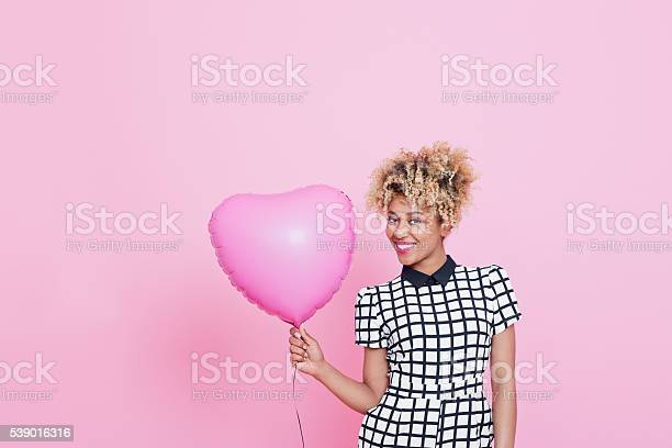 Young Woman With Big Pink Heart Stock Photo - Download Image Now