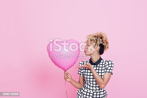 istock Young woman with big pink heart 539016358