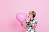 Young woman with big pink heart