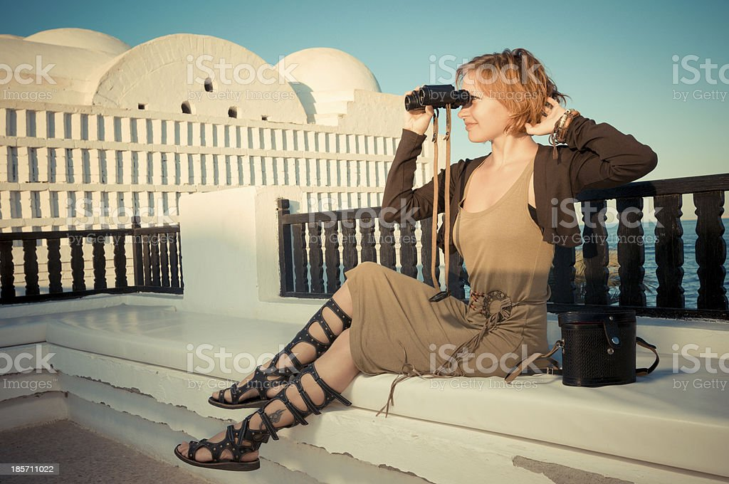 Young woman with binoculars royalty-free stock photo