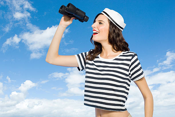 Young woman with binoculars  sailor suit stock pictures, royalty-free photos & images