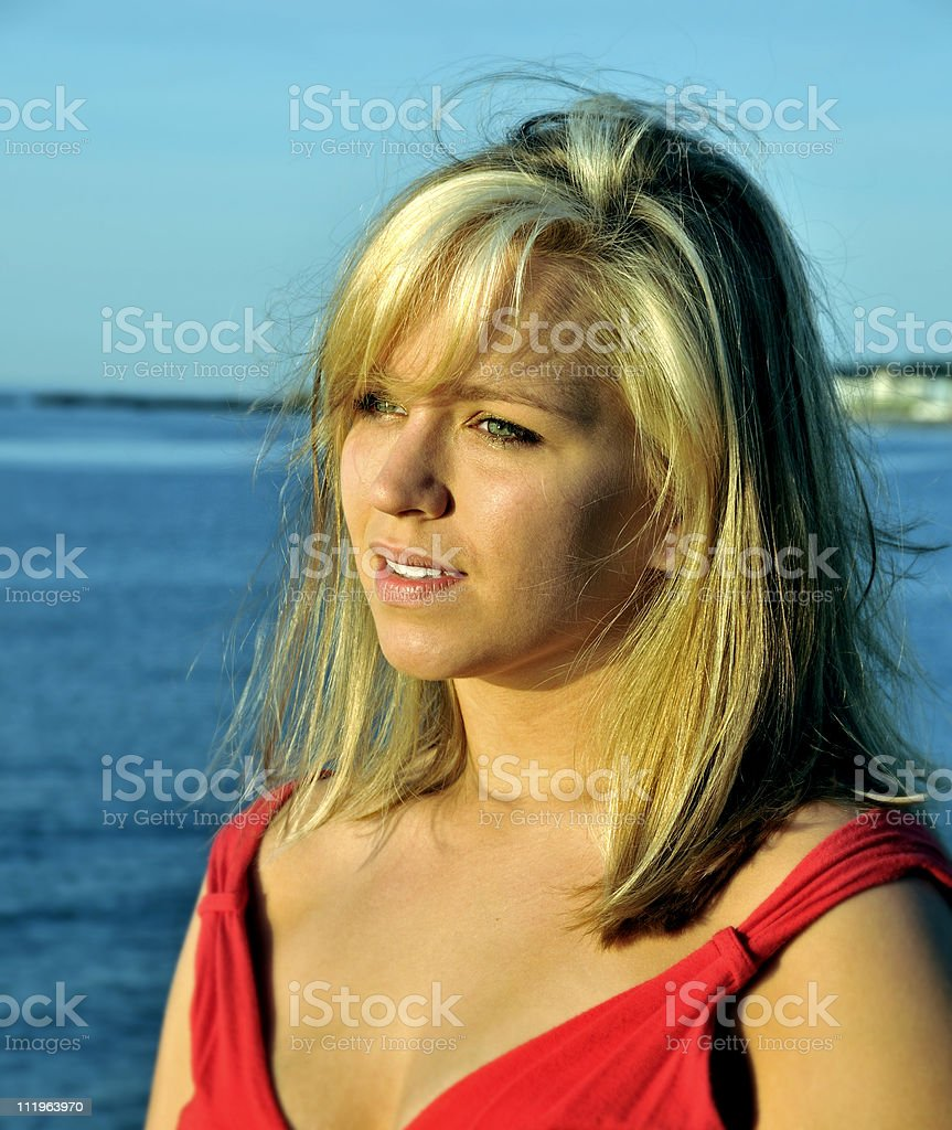 Young Woman With Blonde Highlights In Front Of Ocean Stock Photo