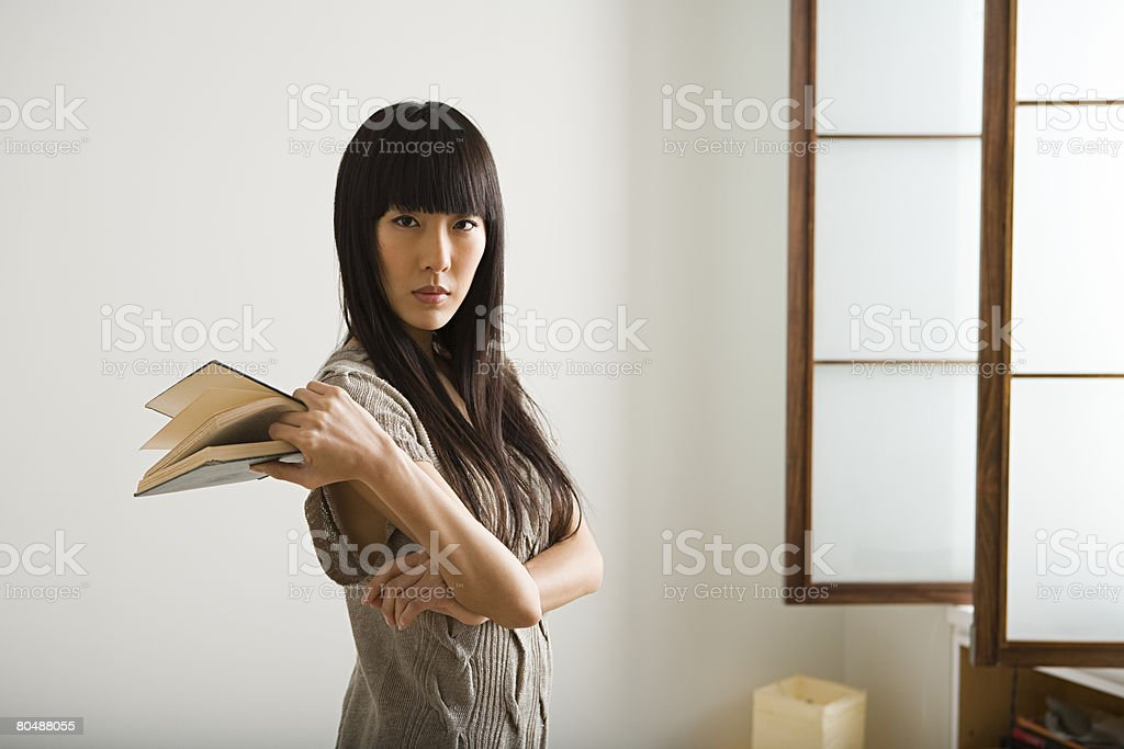 Young woman with book 免版稅 stock photo