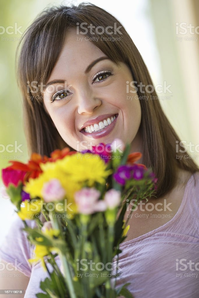 Young Woman With Bouquet Of Flowers royalty-free stock photo