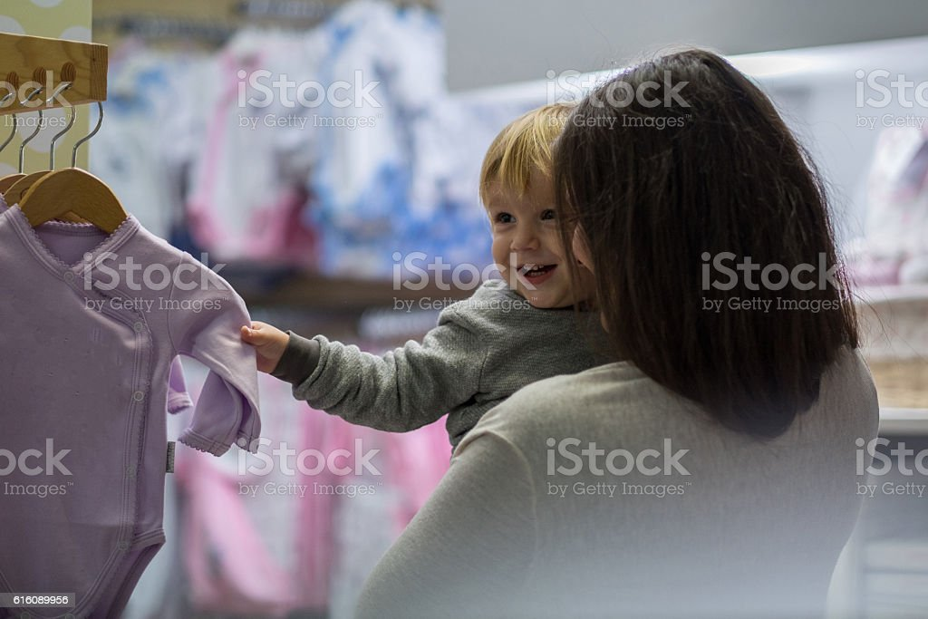 young woman with boy in shopping stock photo