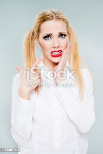 istock Young woman with braces 181957446