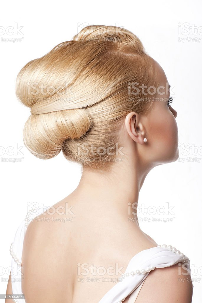 Young woman with bridal hair in white dress stock photo