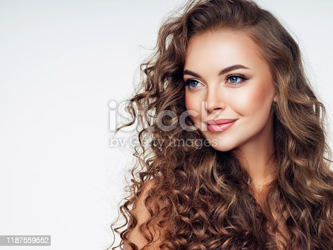 Young woman with brown voluminous and curly hair